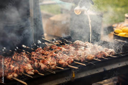 Valokuva delicious bbq kebab grilling on open grill, outdoor kitchen