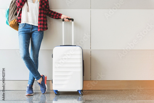 Wallpaper Mural Young woman wearing casual clothes is posing at airport
