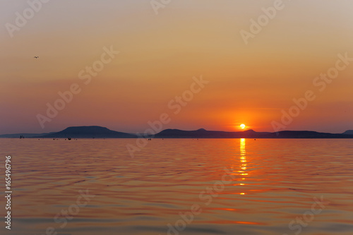 Fotografia, Obraz Sunset wallpaper of Lake Balaton with Badacsony mountains in the Bakcground, in