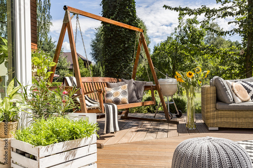 Fototapeta House patio with the garden swing