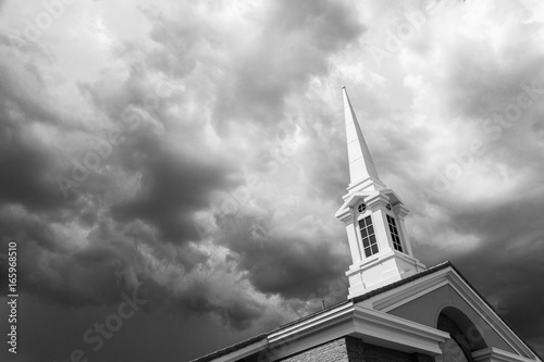 Canvas Print Black and White Church Steeple Tower Below Ominous Stormy Thunderstorm Clouds