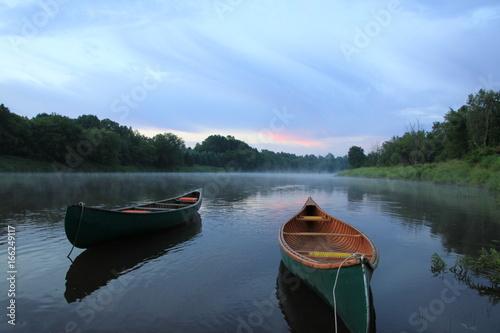 canoe on river in canada sunrise Fototapeta