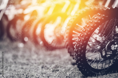 Photo close-up wheel of an off-road motorcycle for a motocross through the mud