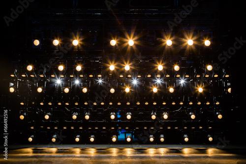 Billede på lærred Spotlights & lighting equipment for the theater. Yellow light.