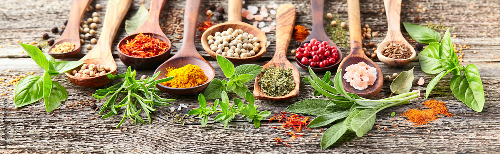 Spices and herbs on a wooden board