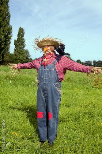 Obraz na płótnie Farmer acting as  scarecrow