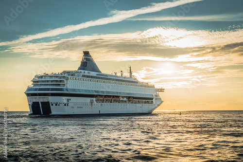Photo The ship sailing away from Latvia to Sweden in the evening