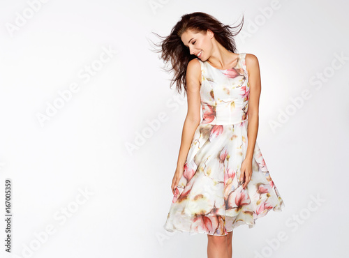 Fotografering Beautiful charming woman poses in summer dress
