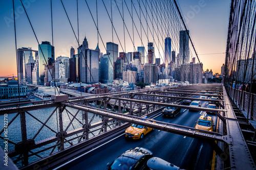 Brooklyn Bridge, Downtown Manhattan, New York. Night scene. Light trails. City lights. Urban living and transportation concept