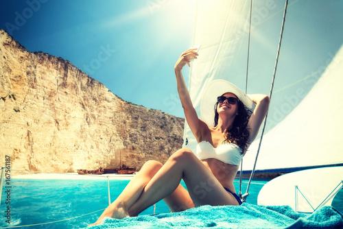 Obraz na plátně Woman on board of sailing yacht