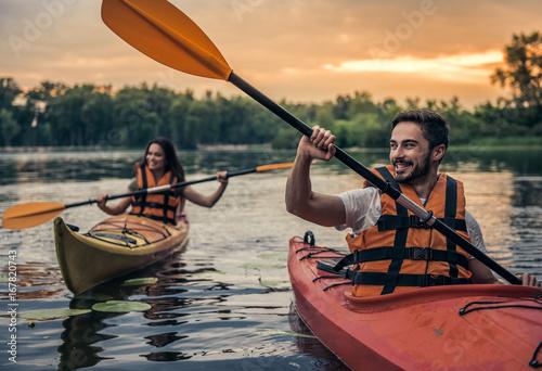 Couple travelling by kayak Fototapeta
