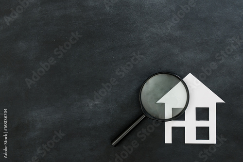 Photo magnifier searching house isolated on chalkboard