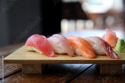 Fototapeta Mix sushi tuna salmon sea bass sushi on wood background japanese food