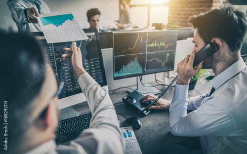 Business team deal on a stock exchange. Stock traders concept. Fototapet