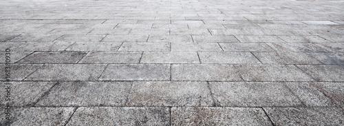 Obraz na płótnie Perspective View of Monotone Gray Brick Stone on The Ground for Street Road