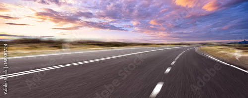 Canvas Print empty road and cityscape of modern city against cloud sky
