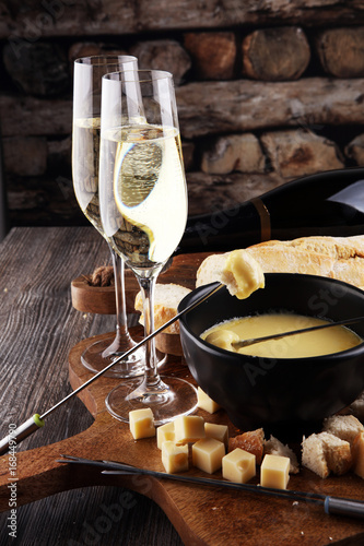 Canvas Print Gourmet Swiss fondue dinner on a winter evening with assorted ch