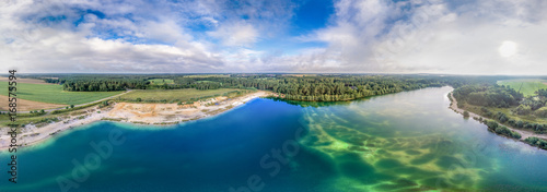 Fotografie, Obraz Panorama from aerial pictures of a big lake after a gravel dismantling
