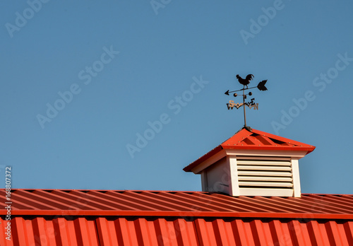 Canvas Print Red Barn with rooster weathervane