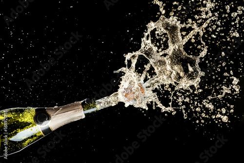 Celebration and holiday theme. Champagne splashes on black background