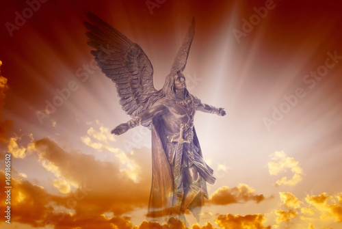 Photographie Angel archangel Michael over divine sky with rays of light