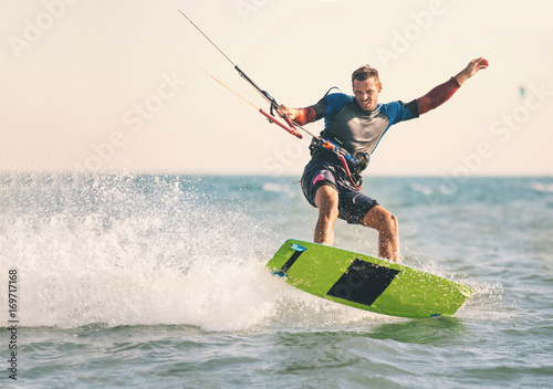 Kitesurfing, Kiteboarding action photos, man among waves quickly goes