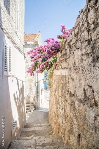 Old street narrow in Korcula, Croatia