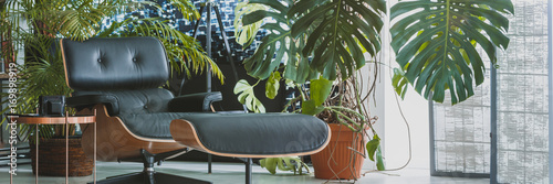 Leather chaise lounge next to coffee table Fototapeta