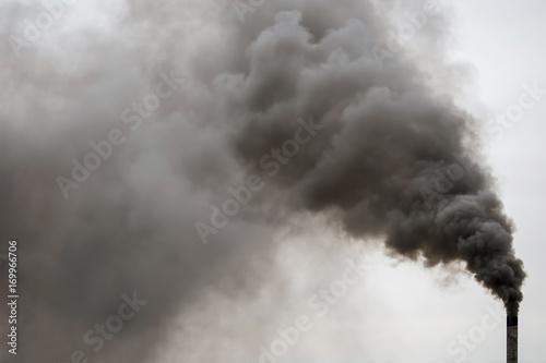 Leinwand Poster Factory chimney smoking, heavy black smoke on the sky.