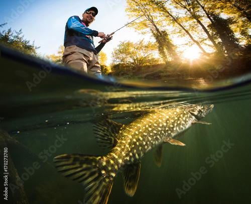 Fishing. Fisherman and pike, underwater view