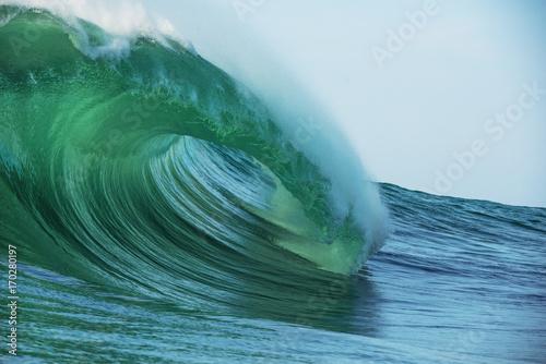 Big beautful perfect surfing waves barreling in the Atlantic Ocean.