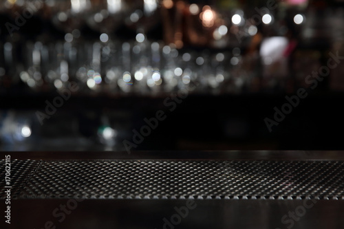Counter bar with glass background in dark tone