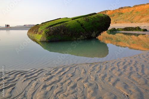 Fotografie, Obraz A destroyed bunker on the beach at sunset in Ambleteuse near Wimereux, Cote d'Op