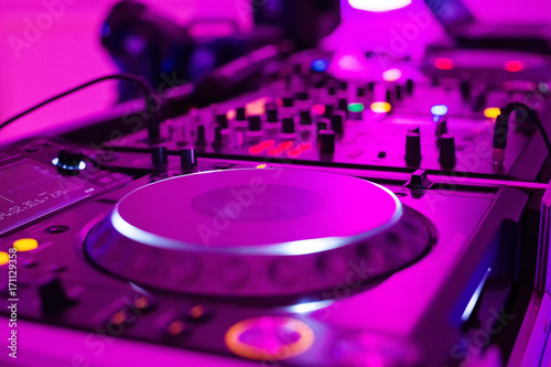 Close-up photo of pro DJ Controller in purple light