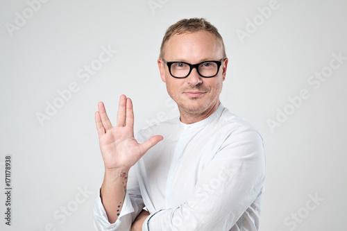 Fotografia Vulcan greeting. Man welcomes fans of fiction films