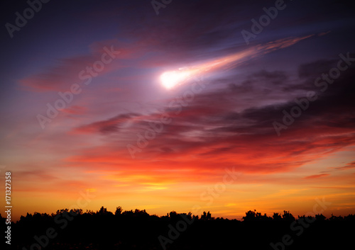 Comet in the sunset sky. Elements of this image furnished by NASA.