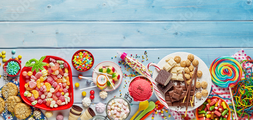 Assorted colourful party sweets with copy space