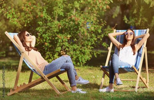 Stampa su Tela Beautiful young women sunbathing in park