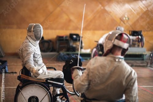 Tableau sur Toile disabled fencers and their trainer at workout