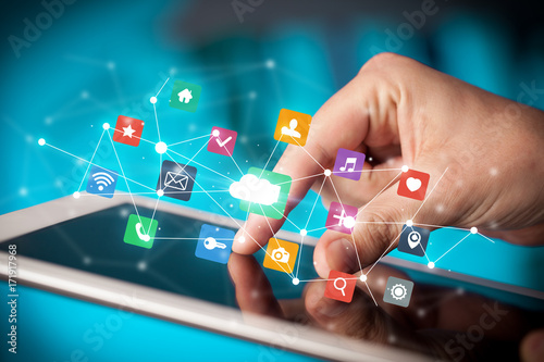 Fingers touching tablet with apps
