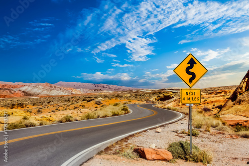 Photo Road Sign for Curves in Desert