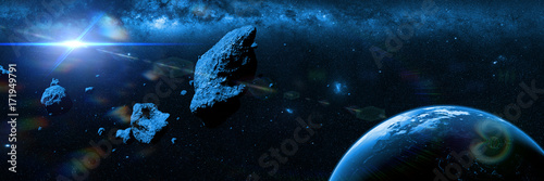 a swarm of asteroids moving towards planet Earth in front of the Milky Way galaxy