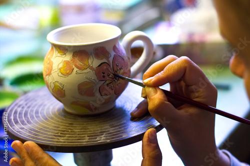 Woman working In her pottery studio Fototapeta