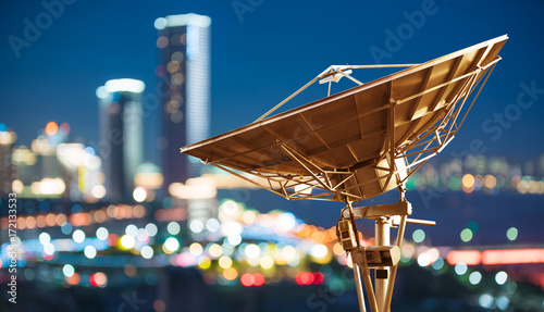 Canvas Print In the city night background large satellite antenna