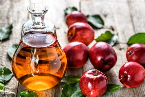 Stampa su Tela Apple cider vinegar or bottle of alcohol drink from fresh apples, organic food,