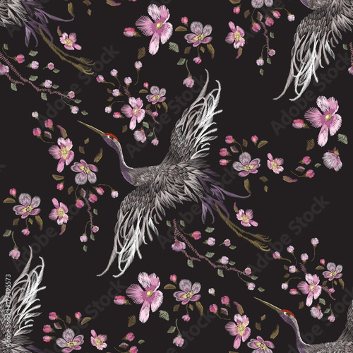 Fototapeta Embroidery oriental seamless pattern with cranes and cherry blossom