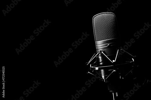 studio condenser microphone, isolated on black Fototapeta