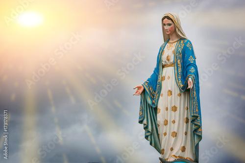 Fototapeta Virgin Mary statue and sunset at the Catholic Church Chanthaburi province, Thailand