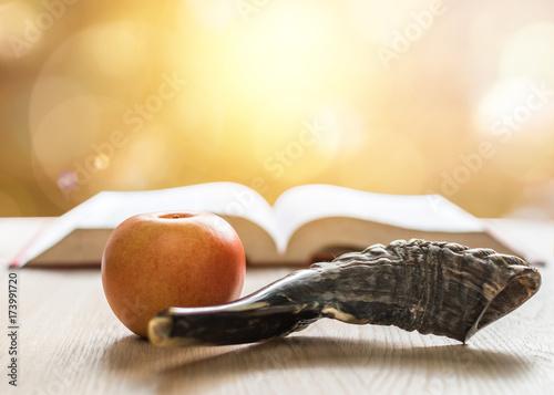 Yom Kippur, Rosh Hashanah (Hashana) jewish New Year, Shemini Atzeret (Shmini Atzeret) and Simchat Torah holiday concept with shofar traditional Israel's ram horn, apple with religious holy prayer book