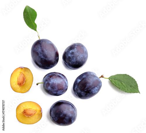 Fresh ripe plums on white background